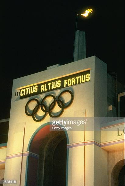 The Olympic Flame burns above the Olympic Rings in the Colliseum Stadium at the closing ceremony of the 1984 Olympic Games in Los Angeles USA...