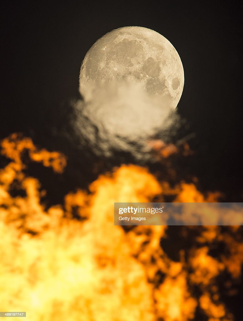 A general view of the Olympic Flame with a full moon on day 6 of the Sochi 2014 Winter Olympics at the Olympic Park on February 13, 2014 in Sochi, Russia.