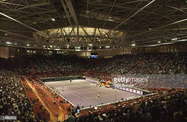 A general view of the packed centre court during the third round match between Feliciano Lopez of Spain and Andre Agassi of the USA during the Tennis...