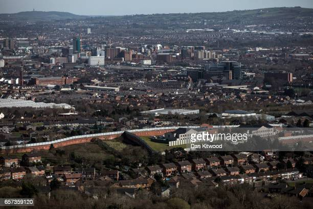 A general view of the 'Peace Wall' separating the Catholic and Protestant communities on March 24 2017 in Belfast United Kingdom First built in 1969...