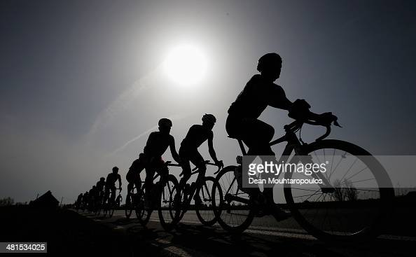 A general view of the peloton silhouetted against the sun during the GentWevelgem Cycle Race on March 30 2014 in Gent Belgium