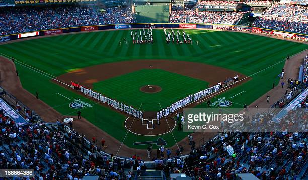 A general view of the Philadelphia Phillies and the Atlanta Braves lined up prior to the National Anthem during Opening Day at Turner Field on April...