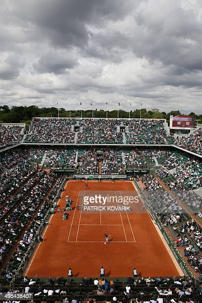 General view of the Philippe Chatrier court taken as Serbia's Novak Djokovic serves to Canada's Milos Raonic during their French tennis Open quarter...