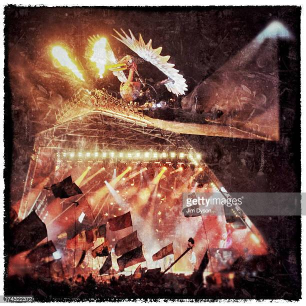 A general view of the phoenix as the Rolling Stones perform on the Pyramid stage during day 3 of the 2013 Glastonbury Festival at Worthy Farm on June...
