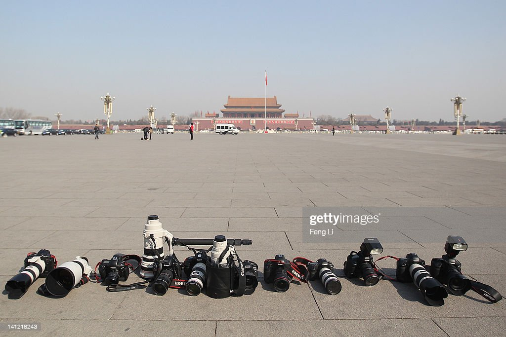 A general view of the photojournalists' cameras and lenses at the Tian'anmen Square after the closing ceremony of the Chinese People's Political Consultative Conference (CPPCC) outside on March 13, 2012 in Beijing, China. Known as 'liang hui,' or 'two organizations', it consists of meetings of China's legislature, the National People's Congress (NPC), and its advisory auxiliary, the Chinese People's Political Consultative Conference (CPPCC).