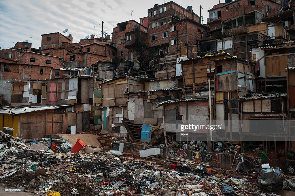 General view of the place where was a fire is seen at Paraisopolis shantytown in Sao Paulo, Brazil on November 30, 2012. According to the city's fire department, no casualty was reported and around 30 homes were burnt. AFP PHOTO/Yasuyoshi CHIBA