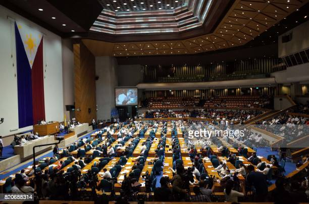 A general view of the plenary hall of Philippine Congress shows Filipino congressmen deliberating on the extension of Martial Law in Mindanao island...