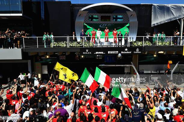 A general view of the podium with Sebastian Vettel of Germany and Ferrari Valtteri Bottas of Finland and Mercedes GP and Kimi Raikkonen of Finland...