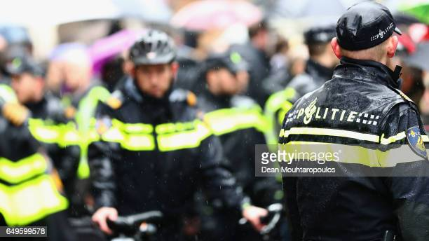 A general view of the police as they protect PVV Candidate Geert Wilders as he speaks to the crowd hands out pamphlets or flyers and poses for...