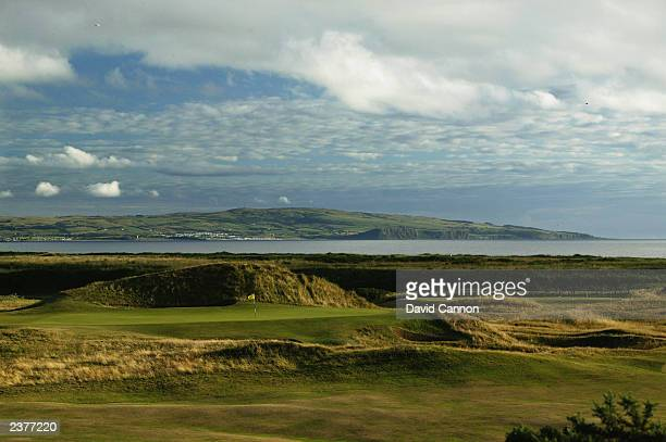 General view of the 'Postage Stamp' par 3 8th green with the town of Ayr behind taken during a photoshoot held on July 26 2003 at the Royal Troon...