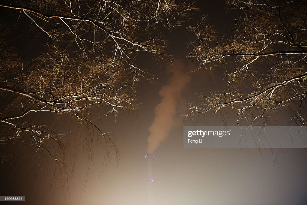 A general view of the power station chimney near the central business district during severe pollution on January 18, 2013 in Beijing, China.
