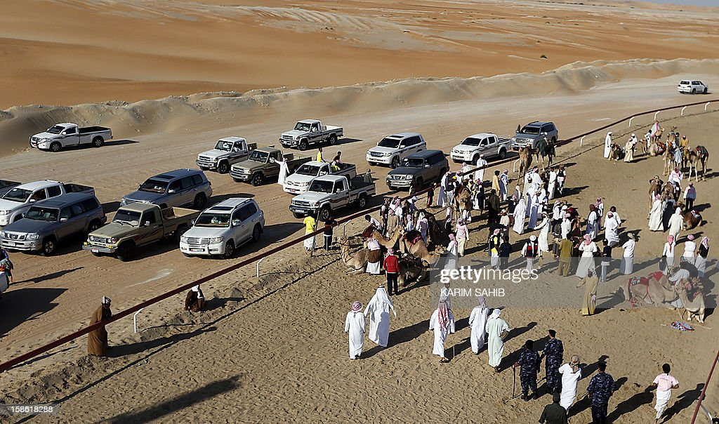 A general view of the race track at the Mazayin Dhafra Camel Festival, on December 21, 2012 near the city of Madinat Zayed, 150 kms west of Abu Dhabi. The festival, which attracts participants from around the Gulf region, includes a camel beauty contest, a display of UAE handcrafts and other activities aimed at promoting the country's folklore .