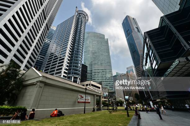 A general view of the Raffles Place financial district in Singapore on March 31 2016 Credit ratings firm Moody's on March 31 downgraded its outlook...