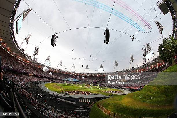 A general view of the Red Arrows the Royal Air Force aerobatic team flying over the stadium during the Opening Ceremony of the London 2012 Olympic...