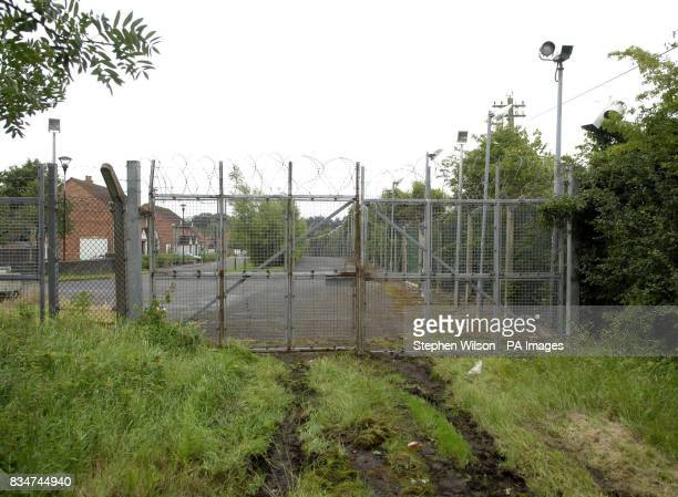 A general view of the repaired security fence of RAF Aldergrove near Belfast which was breached when a car was smashed through the perimeter fence at...