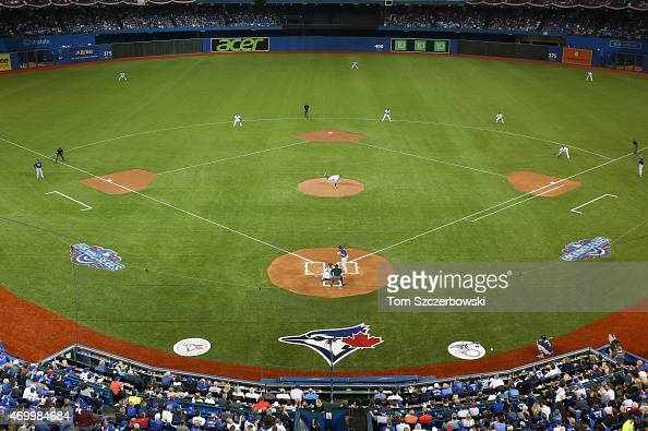 A general view of the Rogers Centre as RA Dickey of the Toronto Blue Jays delivers a pitch in the first inning during MLB game action against the...