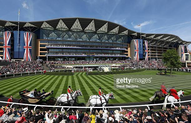 General view of the Royal procession entering the parade ring on day one of Royal Ascot at Ascot Racecourse on June 17 2014 in Ascot England