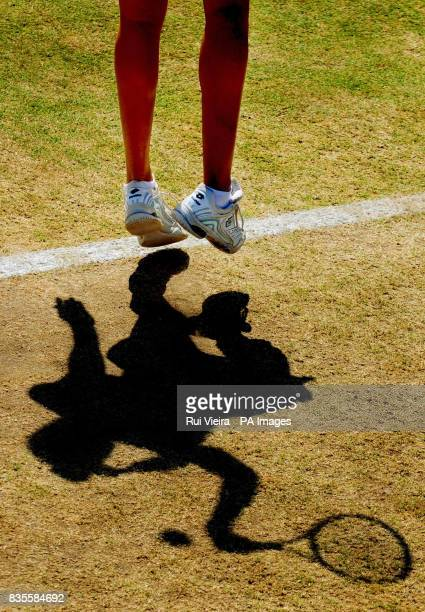 A general view of the shadow cast as Slovakia's Magdalena Rybarikova serves against China's Na Li during the Finals of the AEGON Classic at Edgbaston...
