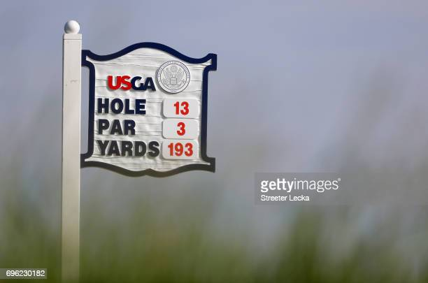 A general view of the sign for the 13th hole during the first round of the 2017 US Open at Erin Hills on June 15 2017 in Hartford Wisconsin