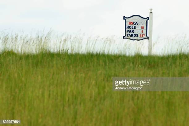 A general view of the sign for the 18th hole during a practice round prior to the 2017 US Open at Erin Hills on June 14 2017 in Hartford Wisconsin