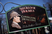 A general view of the sign outside the former home of the fictional Character Sherlock Holmes on March 26 2012 in London England 221B Baker Street is...