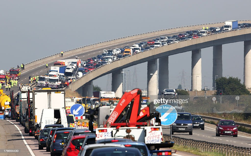 A general view of the site of a major traffic accident on the A249 Sheppey crossing bridge in Kent on September 5, 2013 in Isle of Sheppey, Kent. Over 130 vehicles were involved in the series of accidents, with thick fog blamed for poor visibility. The crash occurred around 07:15AM BST, with at least 8 people suffering serious injuries, and approximately 60 people treated for minor injuries.