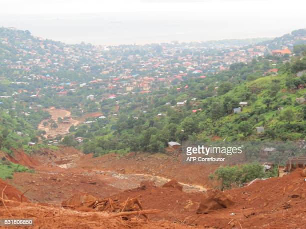 TOPSHOT A general view of the site of a mud slide in the Sierra Leone capital Freetown on August 15 2017 Sierra Leone's president appealed for urgent...
