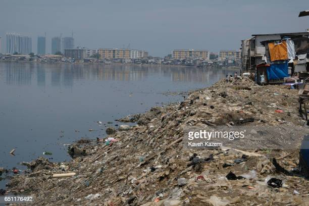 A general view of the slums with human waste seen floating in water and on the banks of river in the old town on November 27 2016 in Jakarta Indonesia