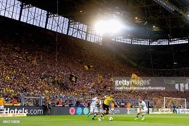 A general view of The south stand or the Die Sudtribune also know to the fans as the Die gelbe Wand or Yellow Wall as Henrikh Mkhitaryan of Borussia...