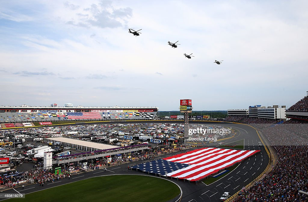 A general view of the speedway as Blackhawk and Apache Longbow helicopters from Task Force Talon, the 82nd Combat Avaiation Brigade, fly over during the national anthem prior to the NASCAR Sprint Cup Series Coca-Cola 600 at Charlotte Motor Speedway on May 25, 2014 in Charlotte, North Carolina.
