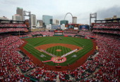 General view of the St Louis Cardinals and the Cincinnati Reds line up for the national anthem before the Opening Day on April 8 2013 at Busch...