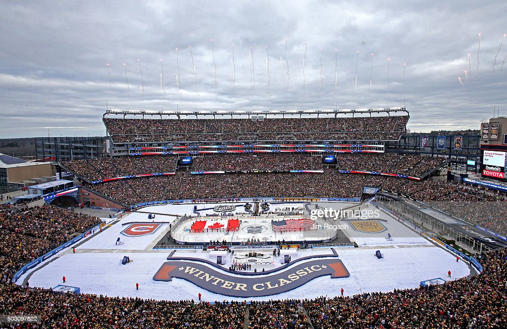 A general view of the stadium as the Canadian and United States flags are held on the ice prior to the 2016 Bridgestone NHL Winter Classic between...