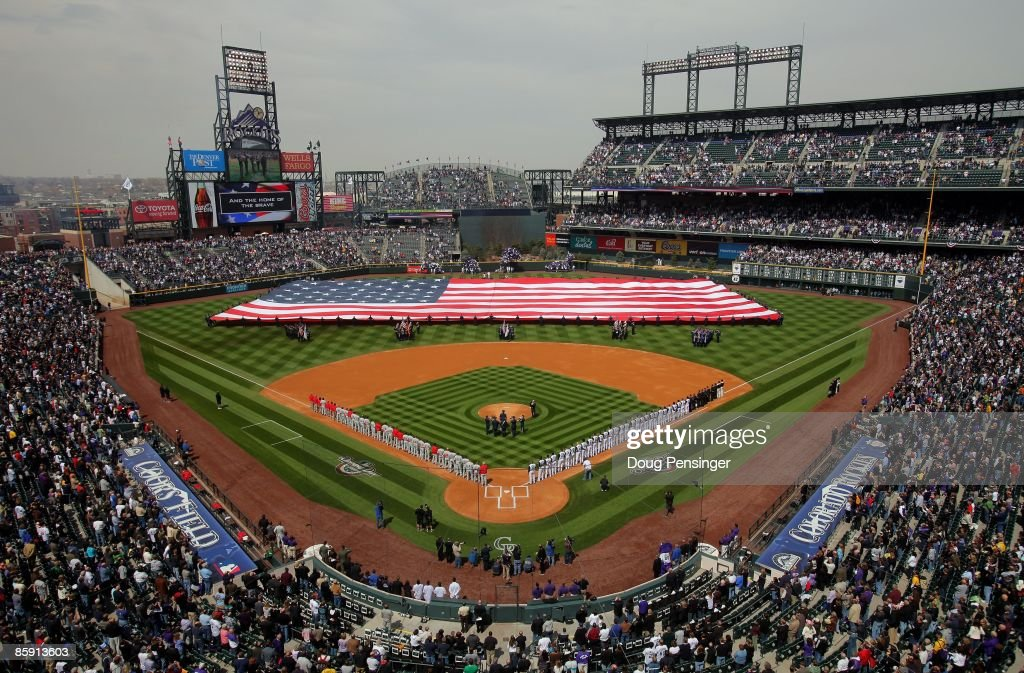 A general view of the stadium as the national anthem is observed by the Philadelphia Phillies and the Colorado Rockies prior to their MLB match up on Opening Day at Coors Field on April 10, 2009 in Denver, Colorado. The Rockies defeated the Phillies 10-3.
