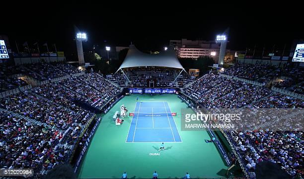 A general view of the stadium shows Novak Djokovic of Serbia and Tunisian Malek Jaziri during their ATP tennis match on the third round of the Dubai...