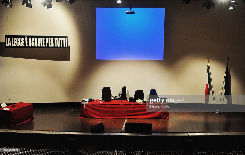 A general view of the stage where the hearing in the trial of the Costa Concordia takes place on December 9, 2013 in Grosseto, Italy. Coastguard Captain Gregorio De Falco and Captain Francesco Schettino met for the first time in court today. De Falco, famous for ordering Schettino back onboard after he allegedly abandoned the ship with hundreds of passengers still onboard, took to the stand as a witness. The Costa Concordia capsized on January 13, 2012 leaving 32 people dead.