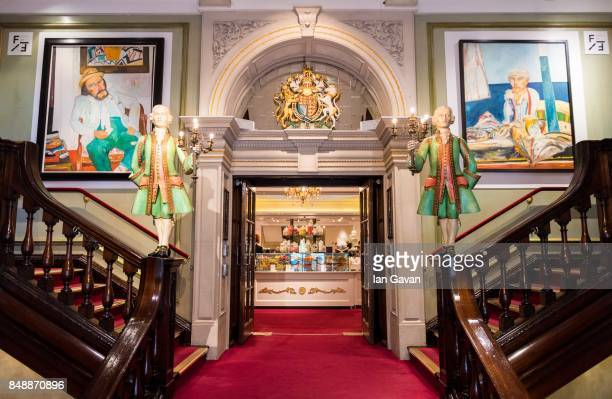 General view of the staircase with John Bellamy paintings at Fortum Mason as Fortnums X Frank 17 sees 50 works by John Bellany go on display until...