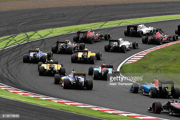 A general view of the start of the race round turn 1 showing Carlos Sainz of Spain driving the Scuderia Toro Rosso STR11 Ferrari 060/5 turbo Daniil...