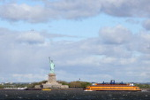 A general view of the Statue of Liberty and the Staten Island Ferry as photographed on April 27 2012 from the Red Hook section of Broooklyn New York