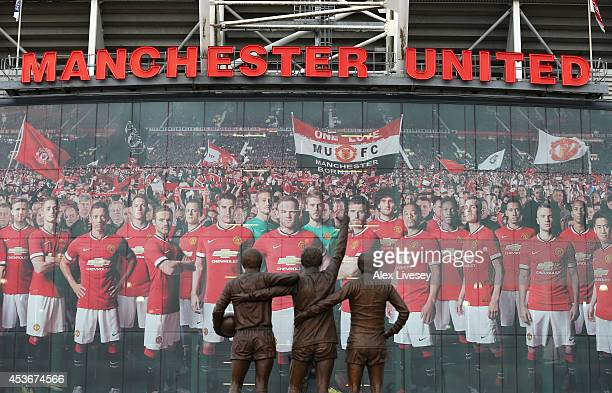 General View of the statues of Denis Law George Best and Bobby Charlton prior to the Barclays Premier League match between Manchester United and...