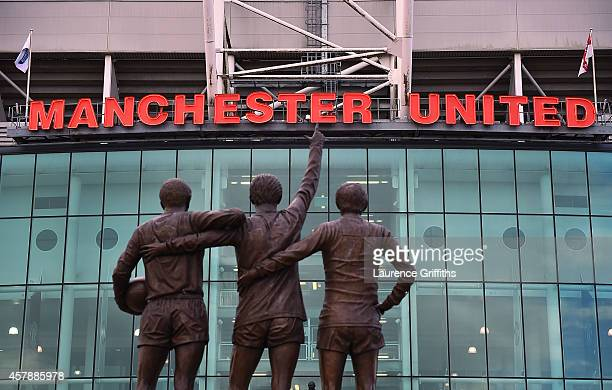 General View of the statues of George Best Denis Law and Sir Bobby Charlton prior to the Barclays Premier League match between Manchester United and...