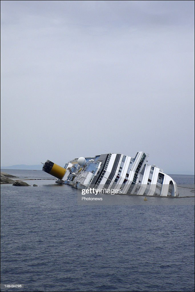A general view of the stricken Costa Concordia, as operations to remove the capsized cruise liner started today. The recovery operations to refloat and remove the cruise ship are organized by the Titan-Micoperi Consortium (American Titan Salvage together with Italian based Micoperi, Cosentino di Palermo, Labromare di Livorno and Cn di Talamone). The C blue, symbol of the cruise boat will be as well removed.