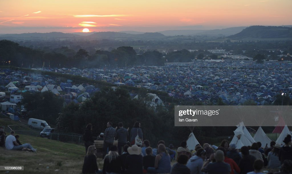 General view of the sun setting on Day 1 of the Glastonbury Festival on June 24, 2010 in Glastonbury, England. This year sees the 40th anniversary of the festival which was started by a dairy farmer, Michael Evis in 1970 and has grown into the largest music festival in Europe.