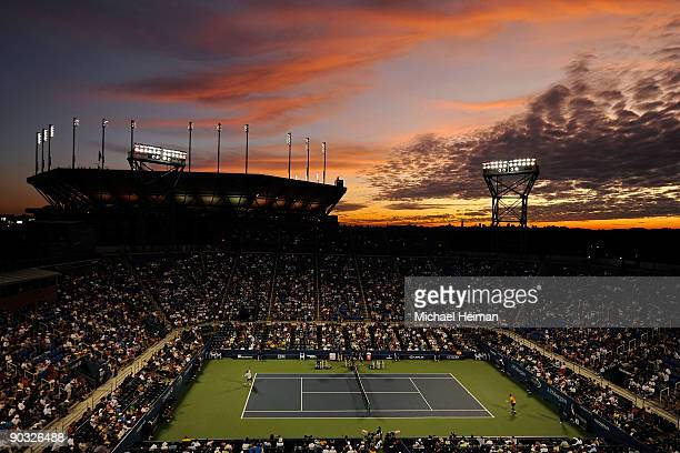 A general view of the sunset over Arthur Ashe Stadium as Novak Djokovic of Serbia plays Carsten Ball of Australia in Louis Armstrong Stadium during...