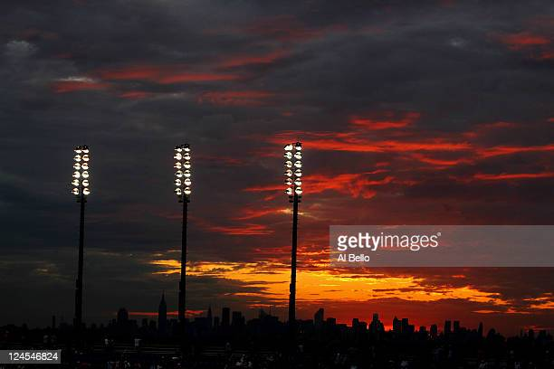 A general view of the sunset over the New York City skyline is seen from the Arthur Ashe Stadium on the grounds of the USTA Billie Jean King National...