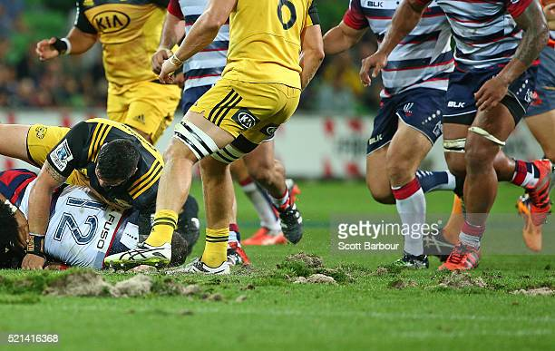 A general view of the surface of AAMI park after large divots of turf were ripped up during a scrum during the round eight Super Rugby match between...