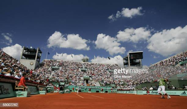 A general view of the Suzanne Lenglen court as Rafael Nadal of Spain is in action during his quarterfinal match against David Ferrer of Spain during...