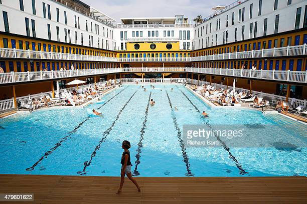 Louis reard stock photos and pictures getty images for Piscine molitor swimming pool