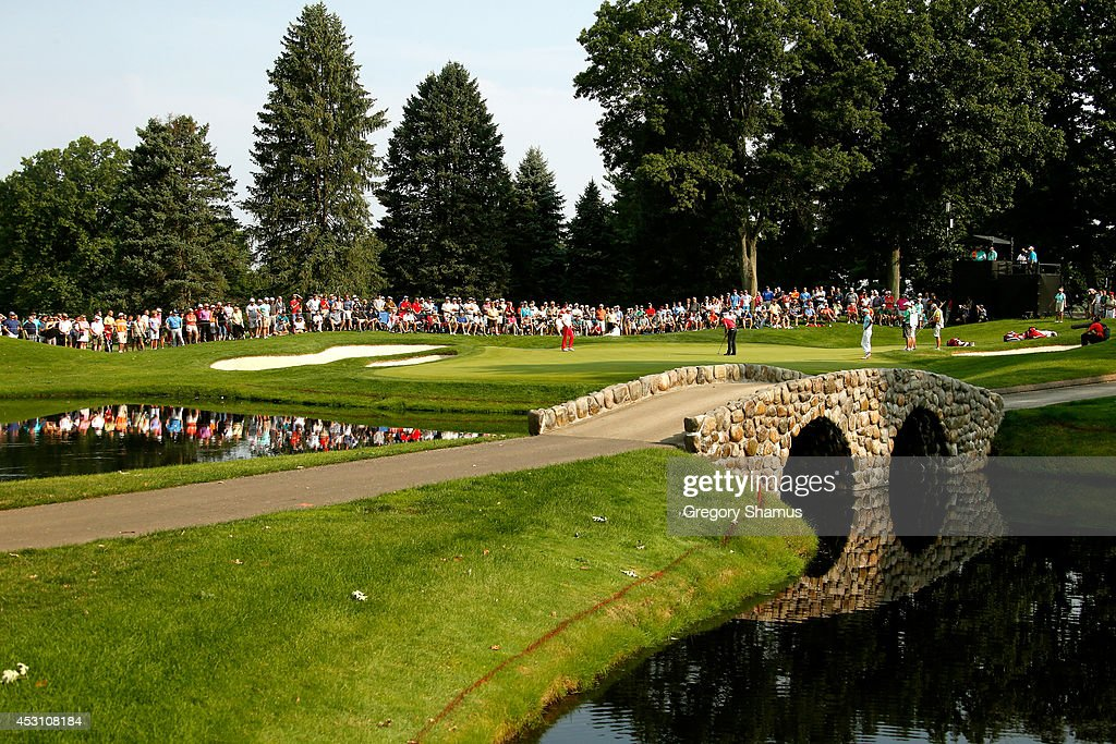 A general view of the third green as Charl Schwartzel of South Africa putts during the third round of the World Golf Championships-Bridgestone Invitational at Firestone Country Club South Course on August 2, 2014 in Akron, Ohio.