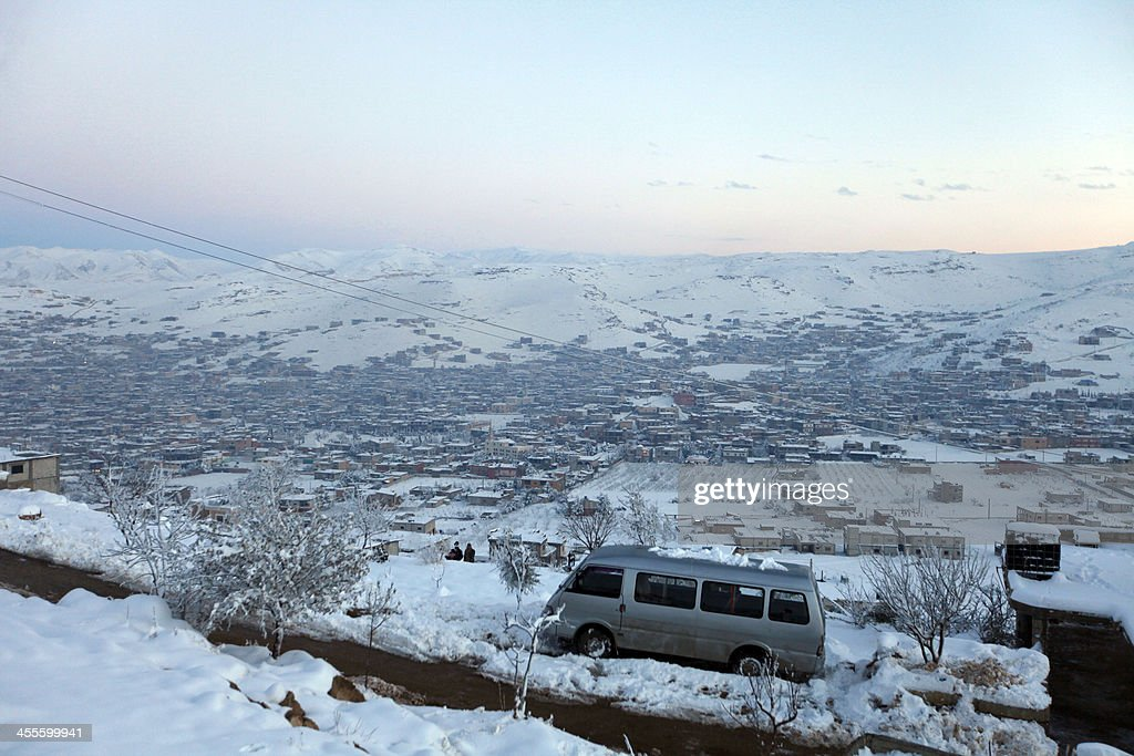 A general view of the town of Arsal in the Lebanese Bekaa valley on December 12, 2013. Thousands of Syrian refugees living in makeshift camps in Lebanon were weathered a winter storm that brought snow, rain and freezing temperatures to the country.