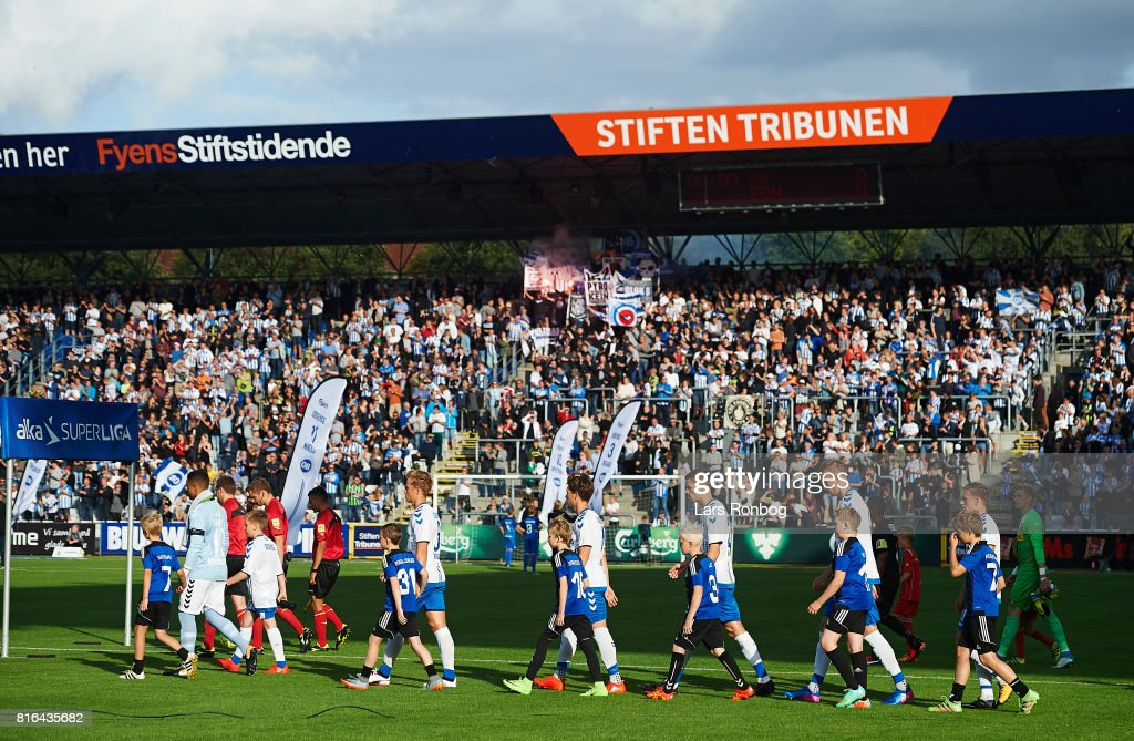 General view of the two teams walking on to the pitch prior to the Danish Alka Superliga match between OB Odense and FC Nordsjalland at EWII Park on July 17, 2017 in Odense, Denmark.